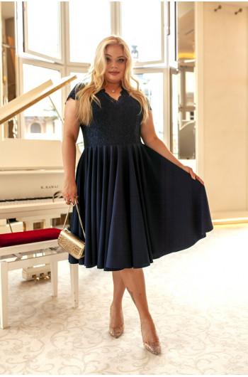 Zachwycająca sukienka Plus...